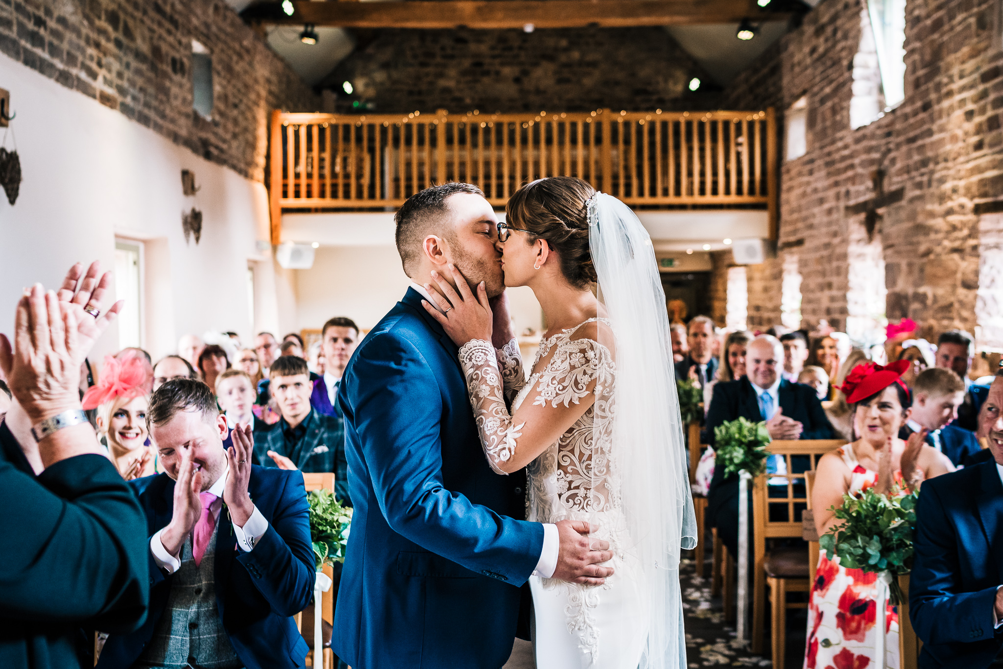 FIRST WEDDING KISS THE ASHES BARN STYLE WEDDING VENUE