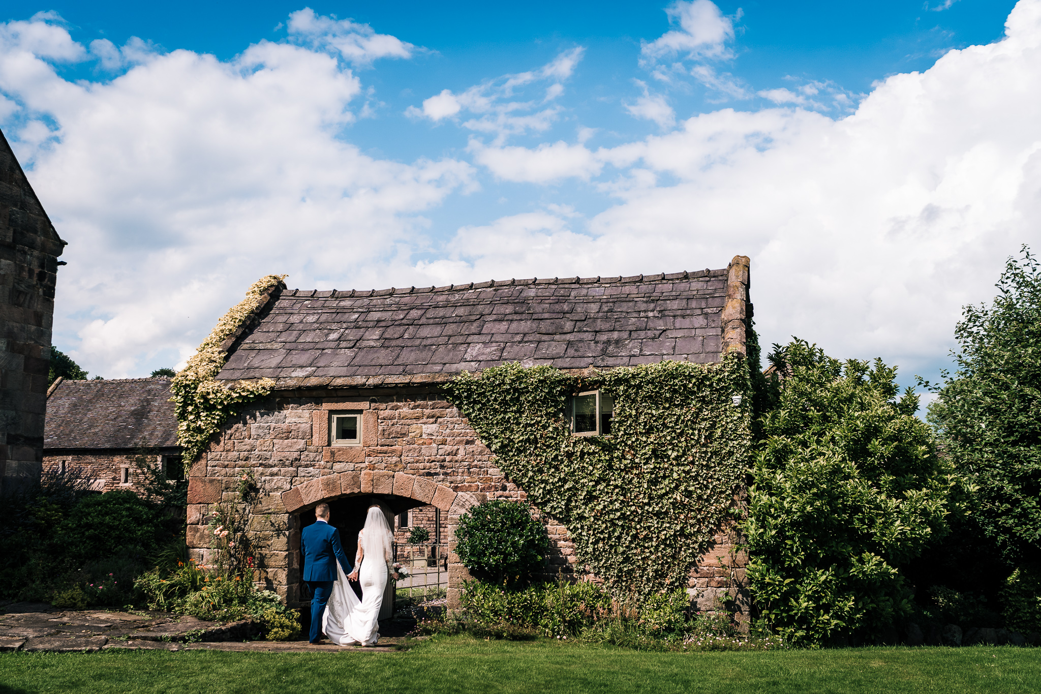 SUMMER WEDDING BRIDE AND GROOM OUTDOORS WITH BLUE SKY
