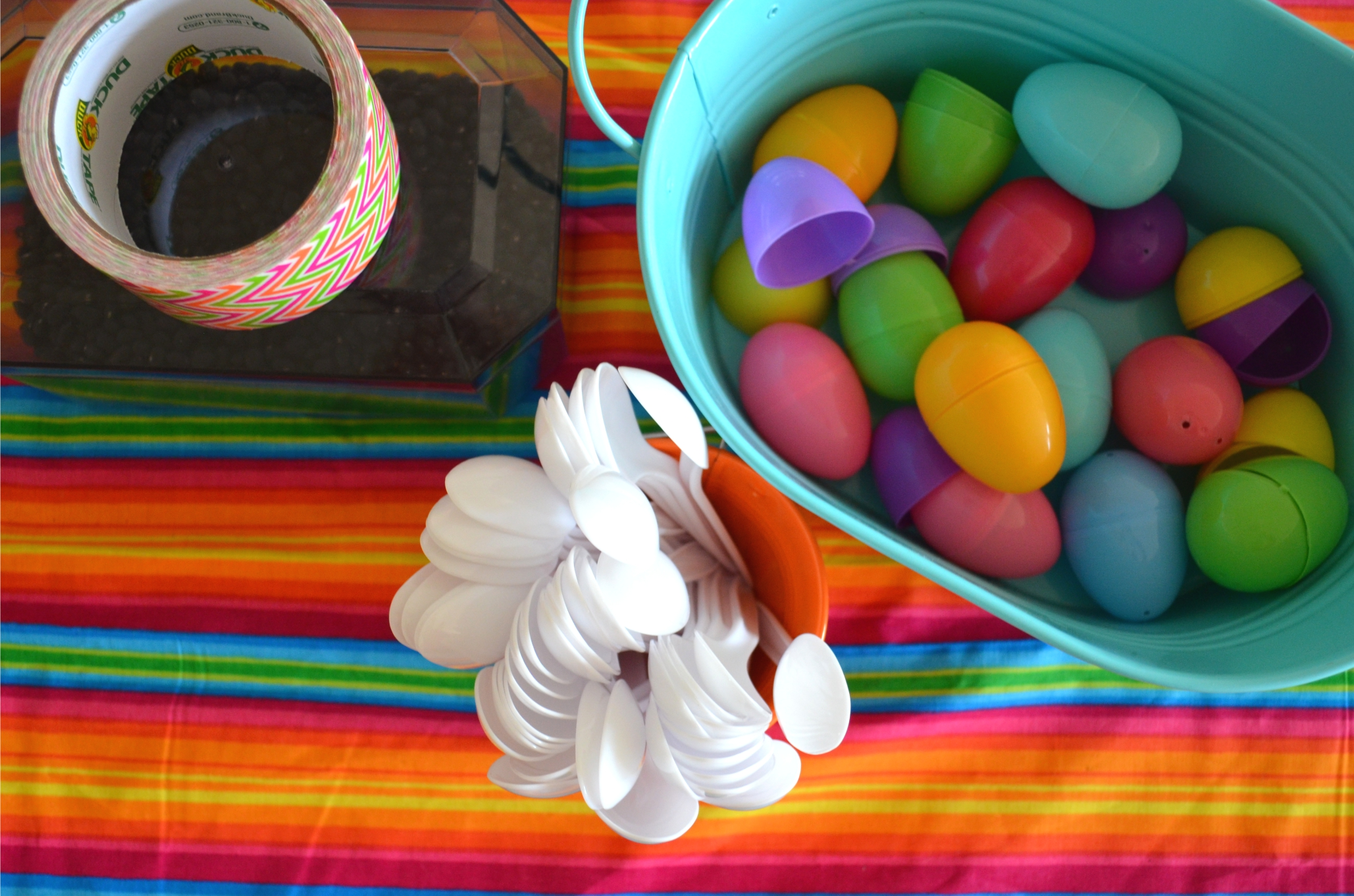 Supplies needed for this: Easter eggs, plastic spoons, rice or beans (dry), and tape.