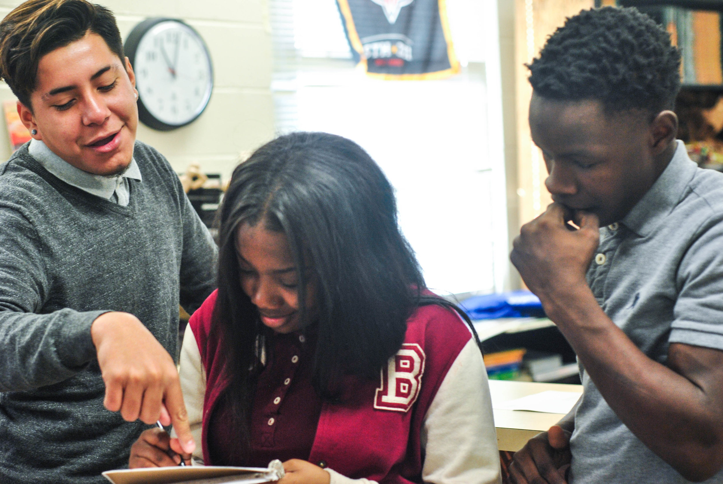 "Howard students review drawings for the ""To Thine Be True"" mural."