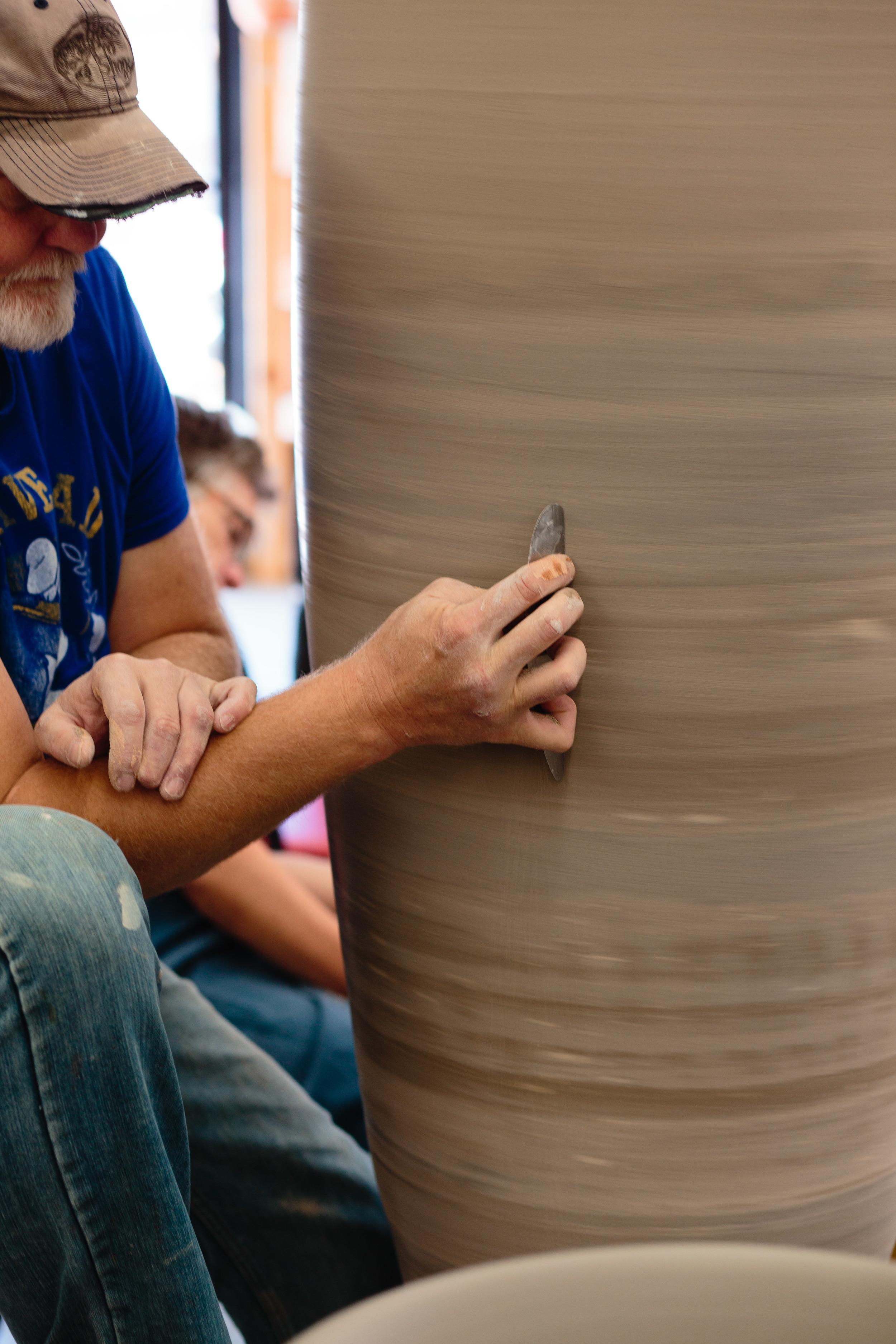 Artist Potter smoothing pot