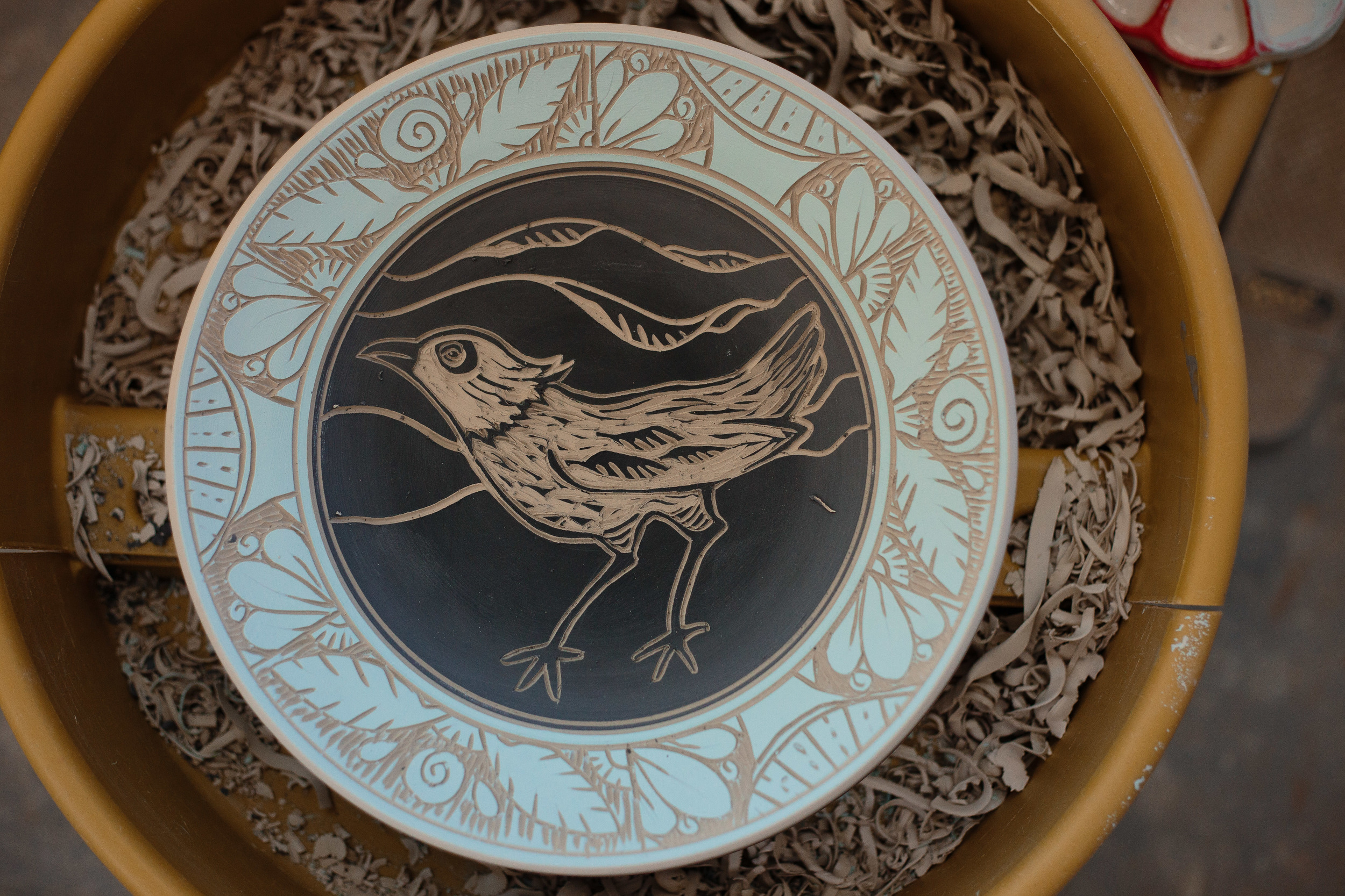 Art piece bird carved clay bowl artisan photographer