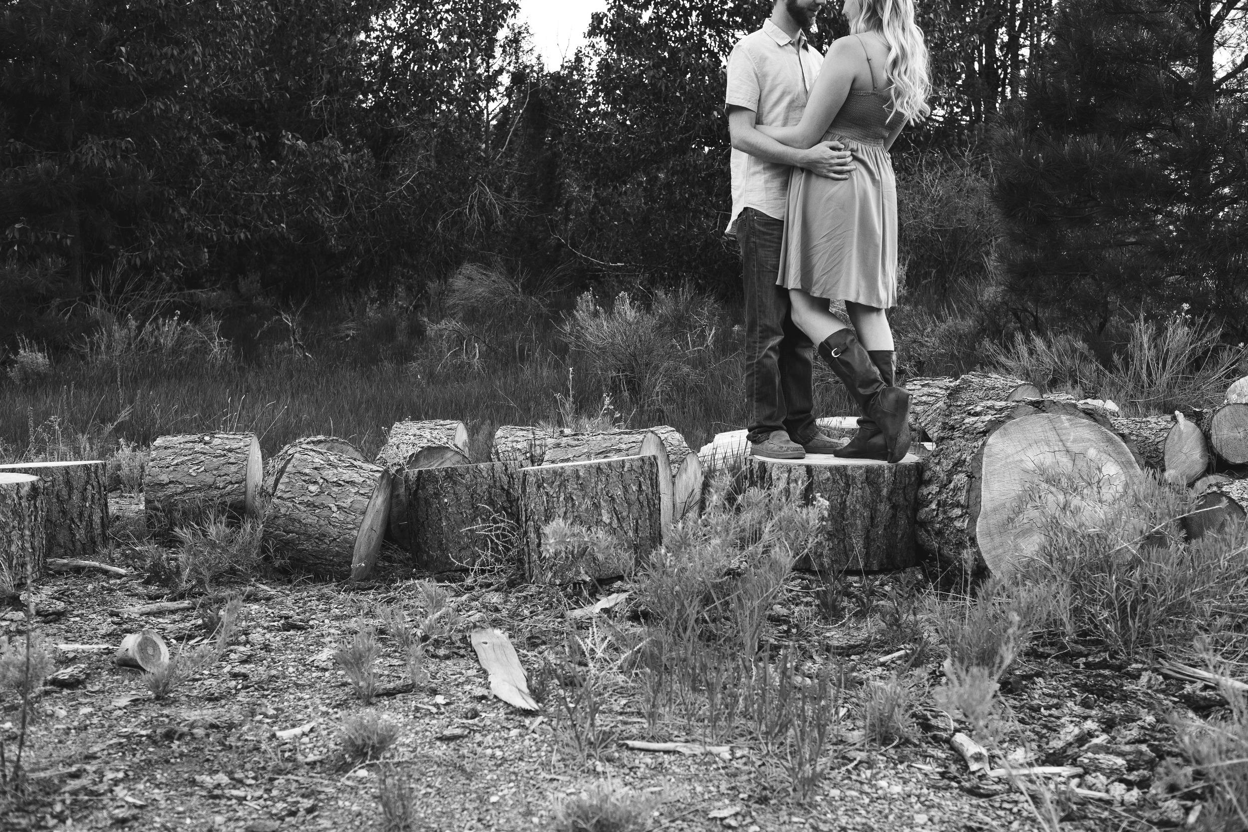 Black and White chopped wood pile photography couple
