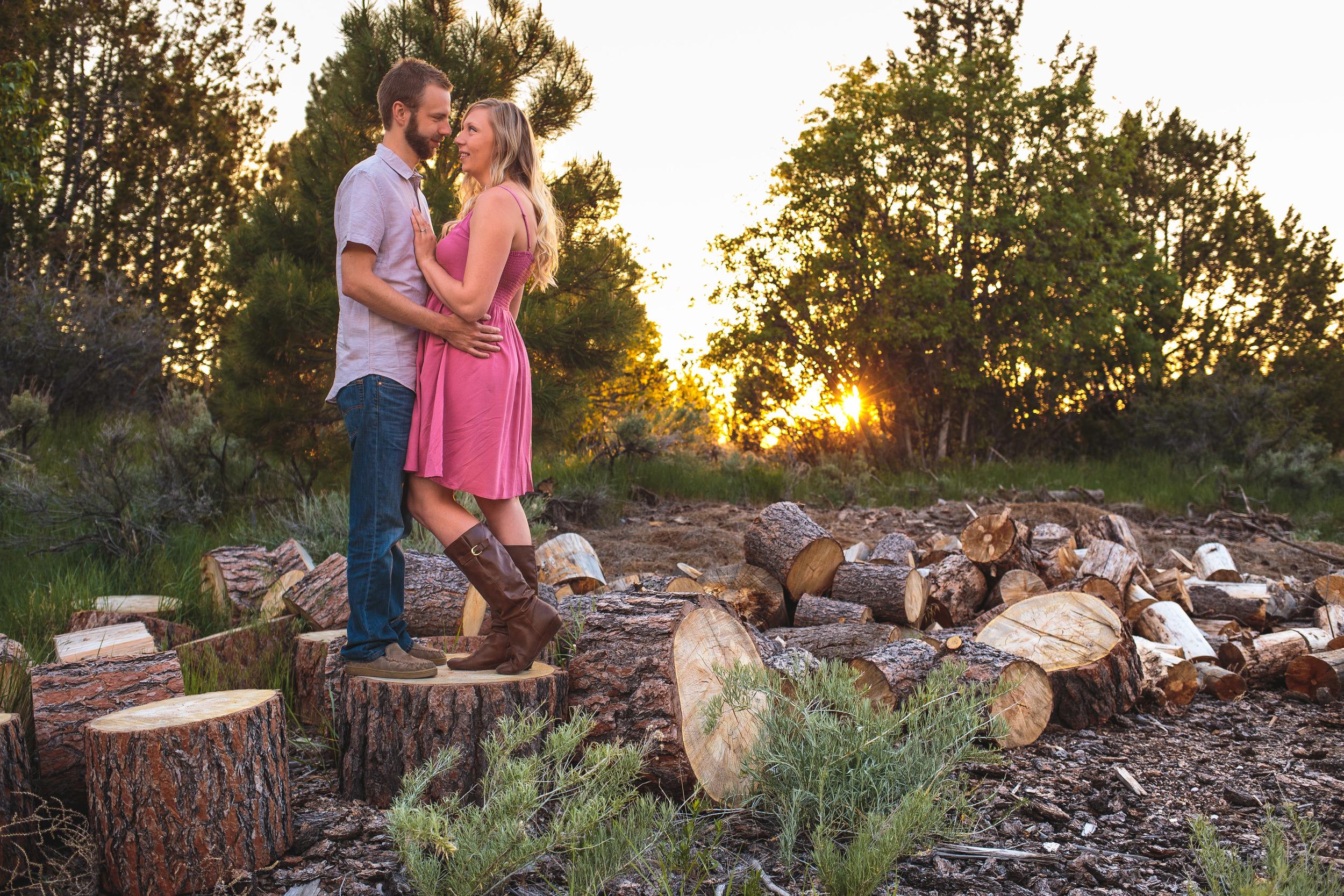 Wood pile couple pose portrait log Utah Photographer
