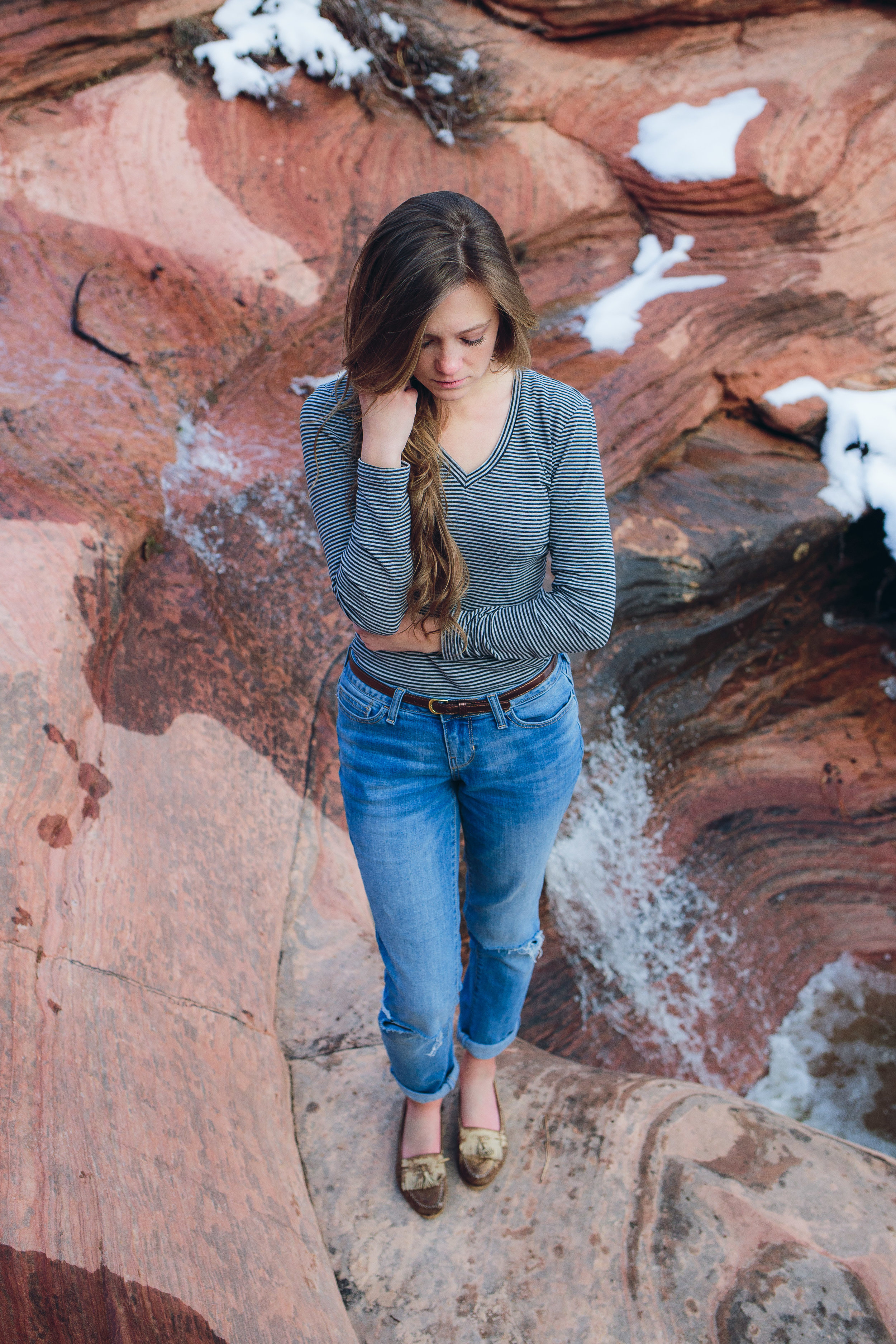 Beautiful girl in Zion red rock water fall