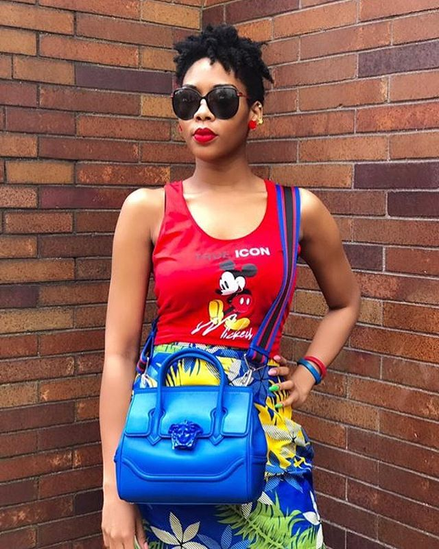 A fun outfit for Friday! I'm sure I'm not the only one obsessed with Mickey Mouse. 📷 @saveenville . . #colorfuloutfit #livecolorfully #photooftheday #fashioninspo #funoutfit #lookoftheday #bloggerstyle #yougotitright #realoutfitgram #outfitoftheday #styleinspo #outfitnspo #fashiondiaries #ootdchannel #fashionaddict #nycbloggers #ilovemickey #naijablogger #nigerianblogger #naijagirlskillingit #blackgirlmagic #ankaraoutfit #iloveankara #versace #ankaraskirt #naturalshorthairstyles #redlips #blackgirlswhoblog #mickeymouse #graphictees