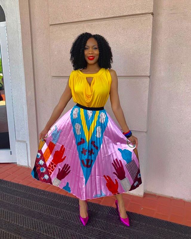 I love graphic everything - tees, dresses, skirts, shoes etc. Graphic skirts are in this summer, so hurry and get yours. If you're feeling adventurous pair it with a print top. But if you want to play it safe, you won't go wrong with a white top. Happy Sunday! 😊🙏🏾😘 . . .  #happyoutfit #colorblocking #metallicskirt #photooftheday #fashioninspo #naijagirl #colorblock #prettyinpink #stylist #graphicclothing #outfitoftheday #styleinspo #outfitnspo #fashiondiaries #crochethairstyles #fashiongirl #colorful #nycbloggers #newyorkbloggers #naijablogger #naijastyle #blackgirlfashion #blackgirlmagic #naijagirlskillingit #summeroutfits #summeroutfit #fashiontips #pleatedskirt #graphicskirt #summercolors