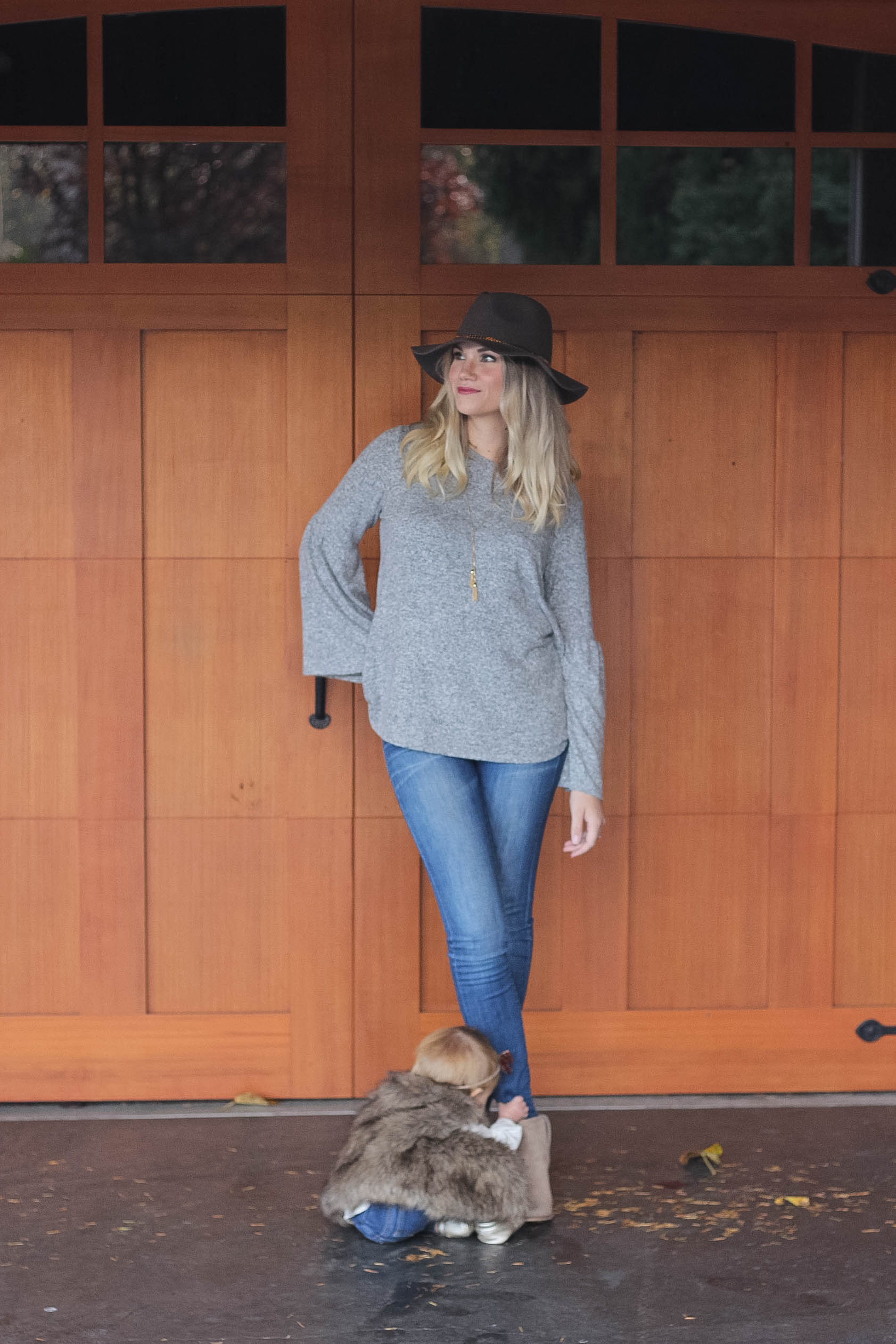 Madewell Jeans  |  Sweater  |  Hinge Boots (Similar Style)  |  Target Hat  |  JCrew Necklace  |  Isla's Fur Vest