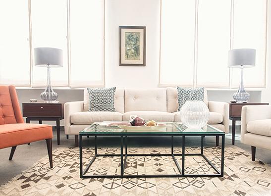 Midcentury modern living room with orange chair