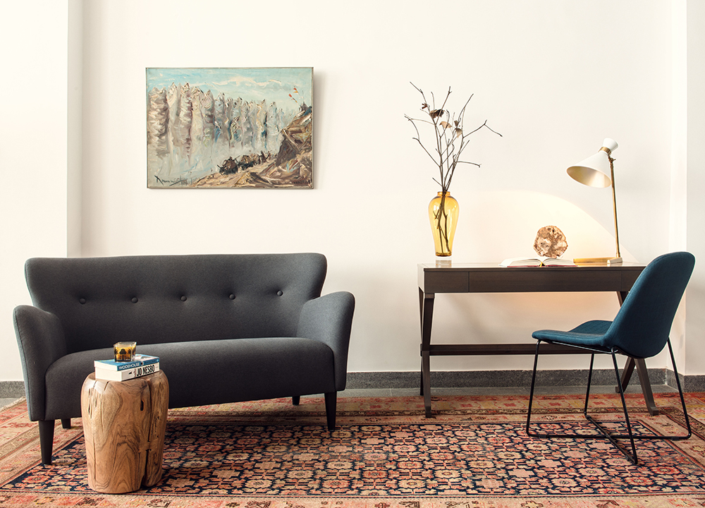 A midcentury modern chic study with 2 seater sofa
