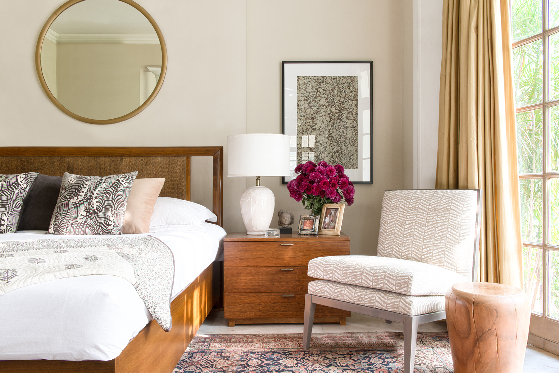 Summer plantation bedroom with Mimosa round wooden stool and Madeleine slipper chair in chic grey bamboo print fabric