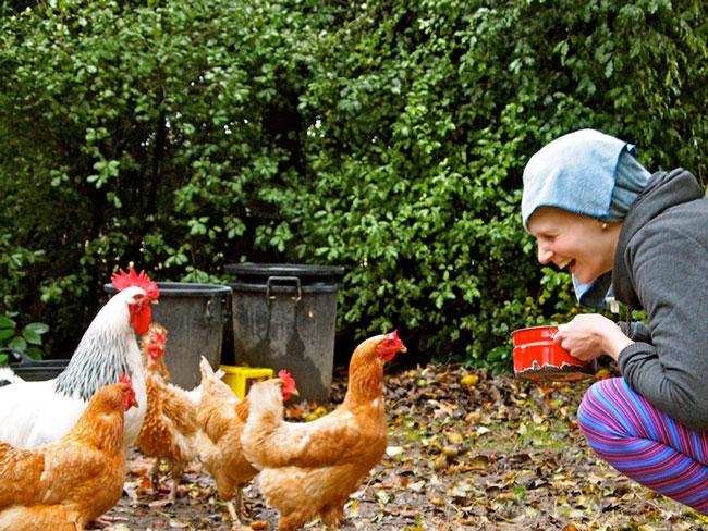 Mud-Brick-Cabin-feeding-chickens.jpg