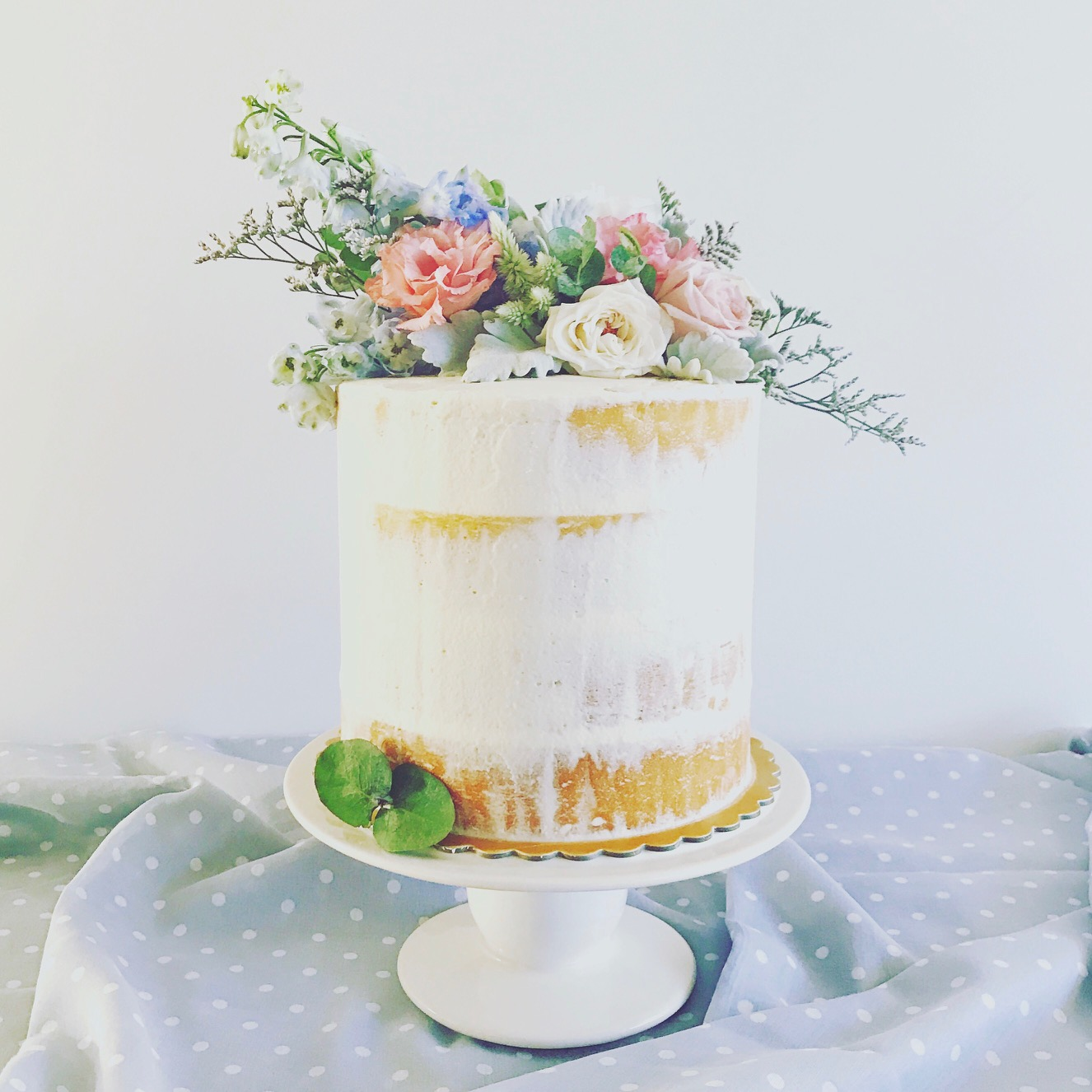 semi-naked cake with fresh flowers