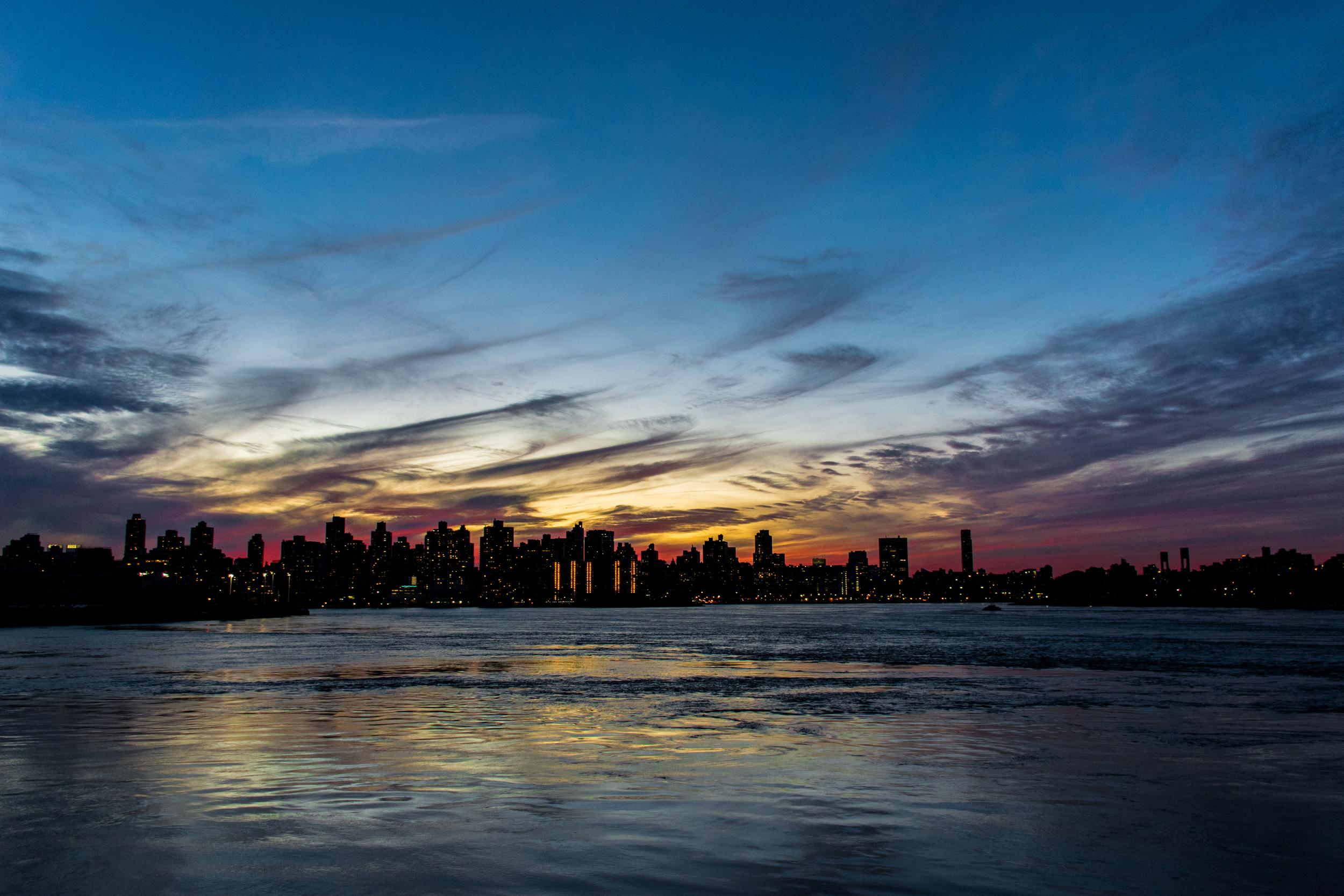Sunset over northern Manhattan from Astoria Park