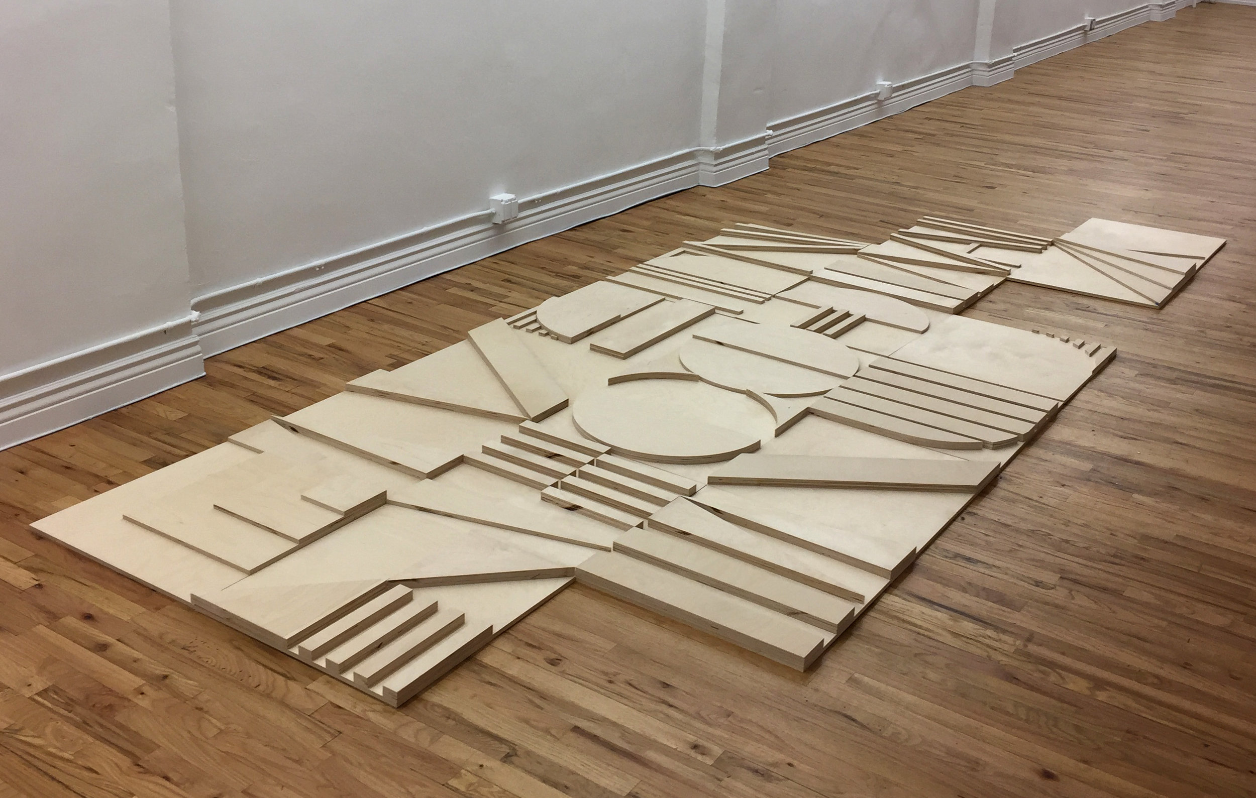 19 panels of birch plywood, to be painted white (work in progress at Hercules Studios)