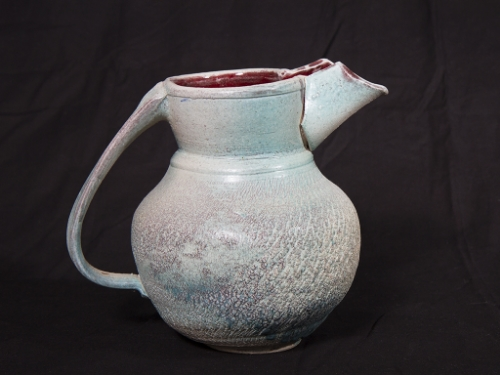 Blue-green textured pitcher.