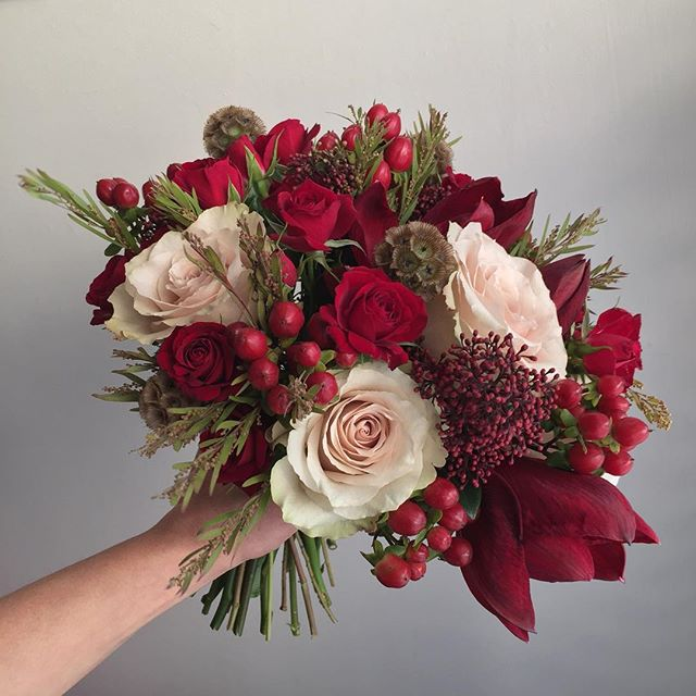 And the bride carried this. Velvety red amaryllis and luxurious nude roses, a perfect December palette. Big love to Sarah & Marcus who married yesterday @botleysmansion ❤️