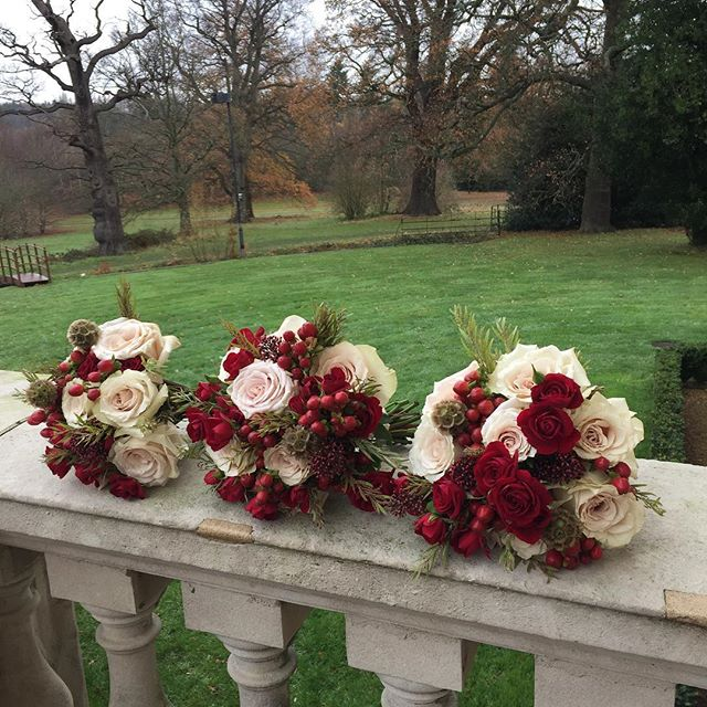 This time last week we were putting the finishing touches to Sarah & Marcus's magical day at @botleysmansion. These creamy 'Quicksand' roses with the dark rich red in the maids bouquets make me happy ❤️