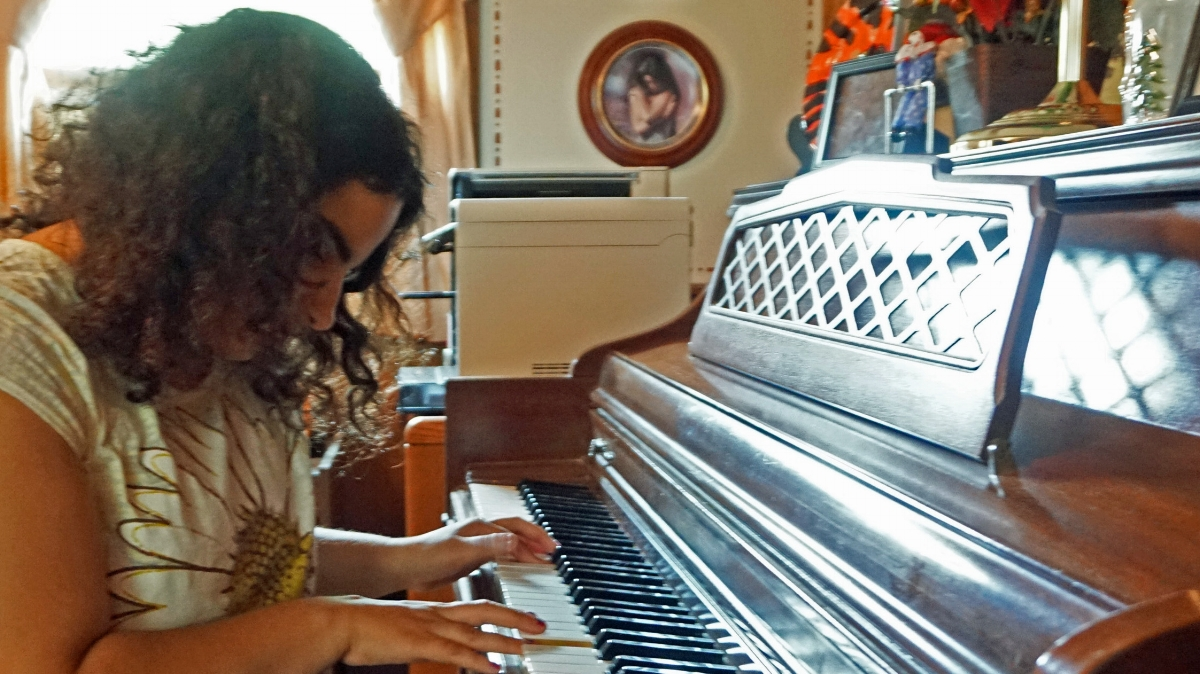 Steven and Jo-Ann DiBiasio's Daughter Plays the  Piano at Home in Cranston                                                                                                                          Photo by Anne Peters