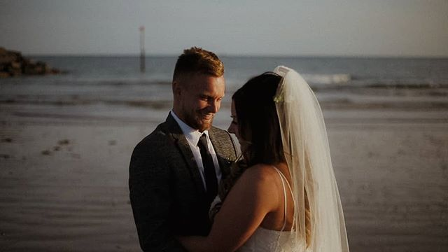 Spending time on the beach on their wedding day; Erin & Josh