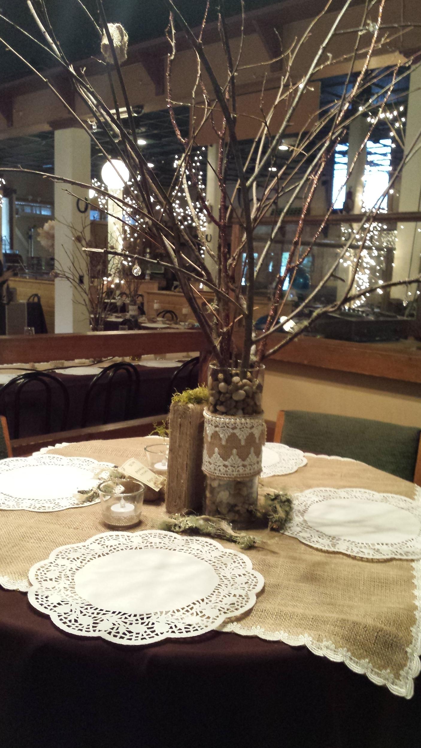 round table,sticks in vase,brown.jpg