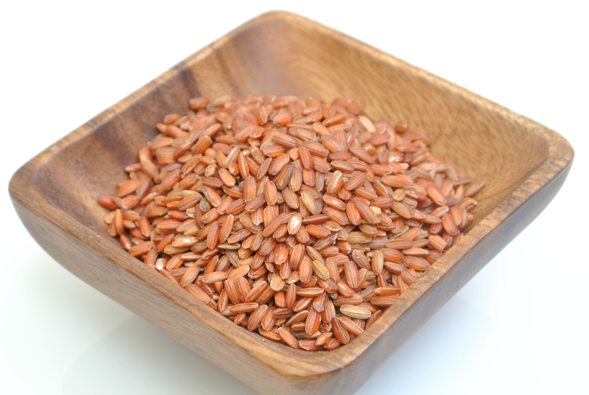 Red rice  is   generally unhulled or hulled rice which has more red husk.  It could refer to a wild variety of rice which has a very low grain yield, some Asian countries regard it as a weed.