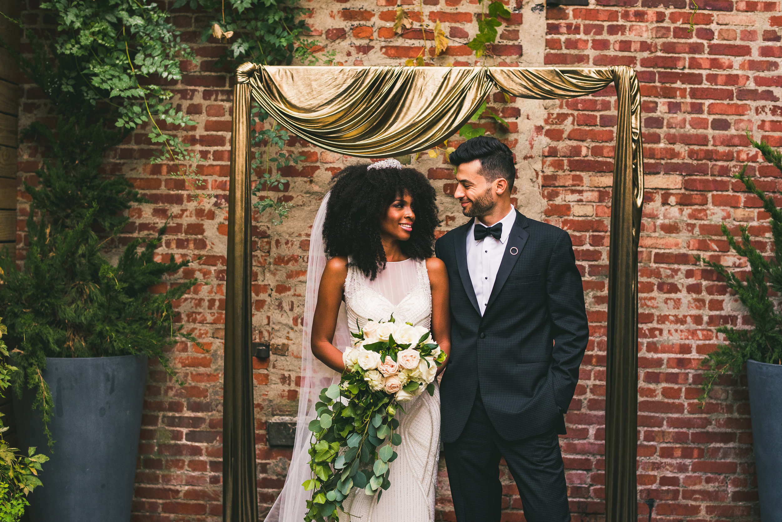 Interracial couple planning modern glam wedding