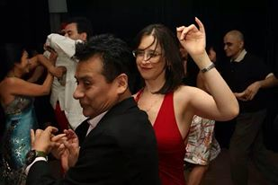Allyna salsa dancing at a Carlos Konig New Year's Eve Party