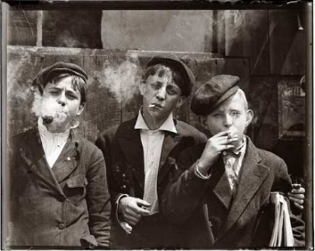 A group of child chimney sweeps taking a break from their workday during the middle Victorian period. These kids can't be much older than 10, but their hardened expressions challenge the photographer to call them tikes or pat them on the head.