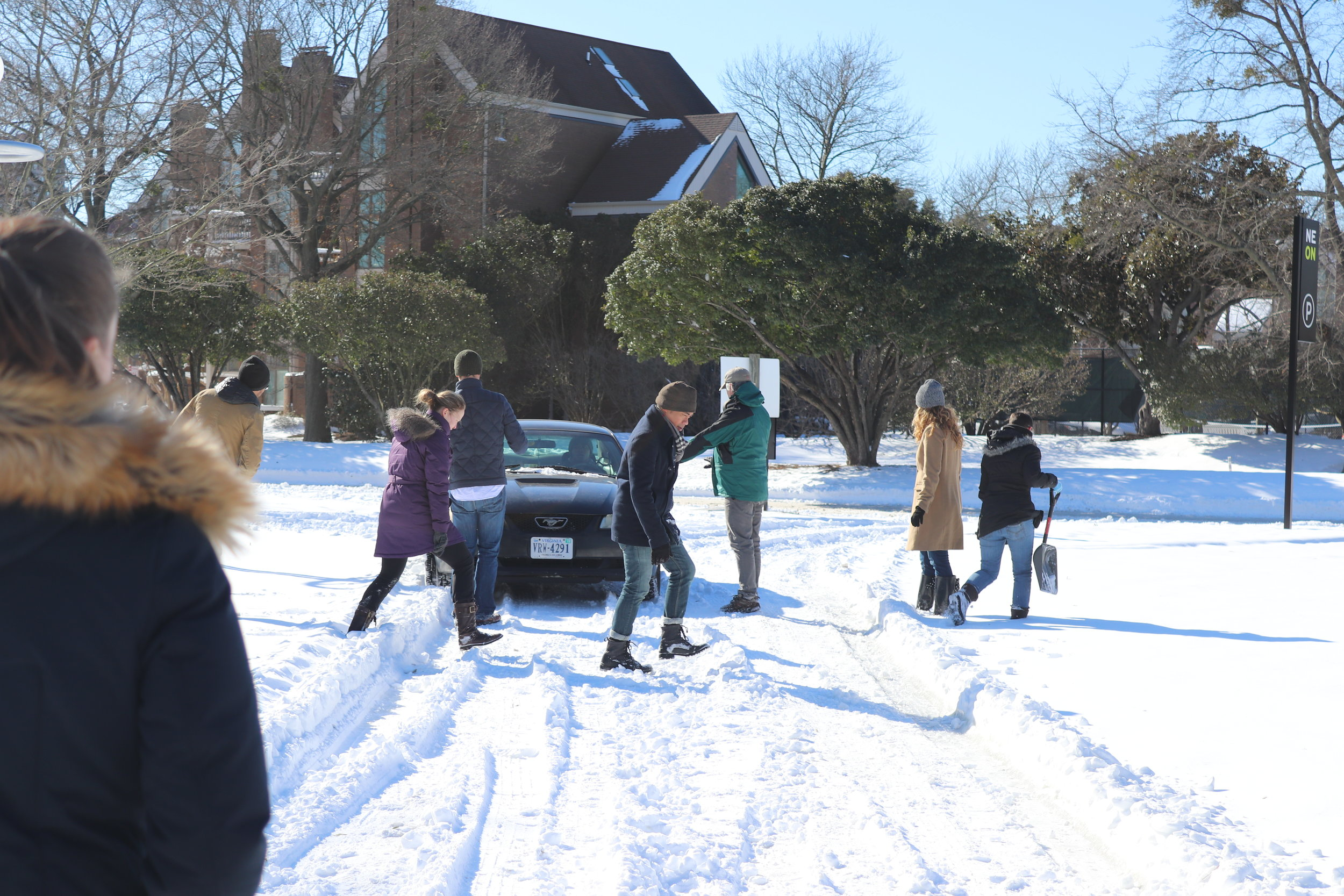 The cast working together to free one of their cars over the weekend.