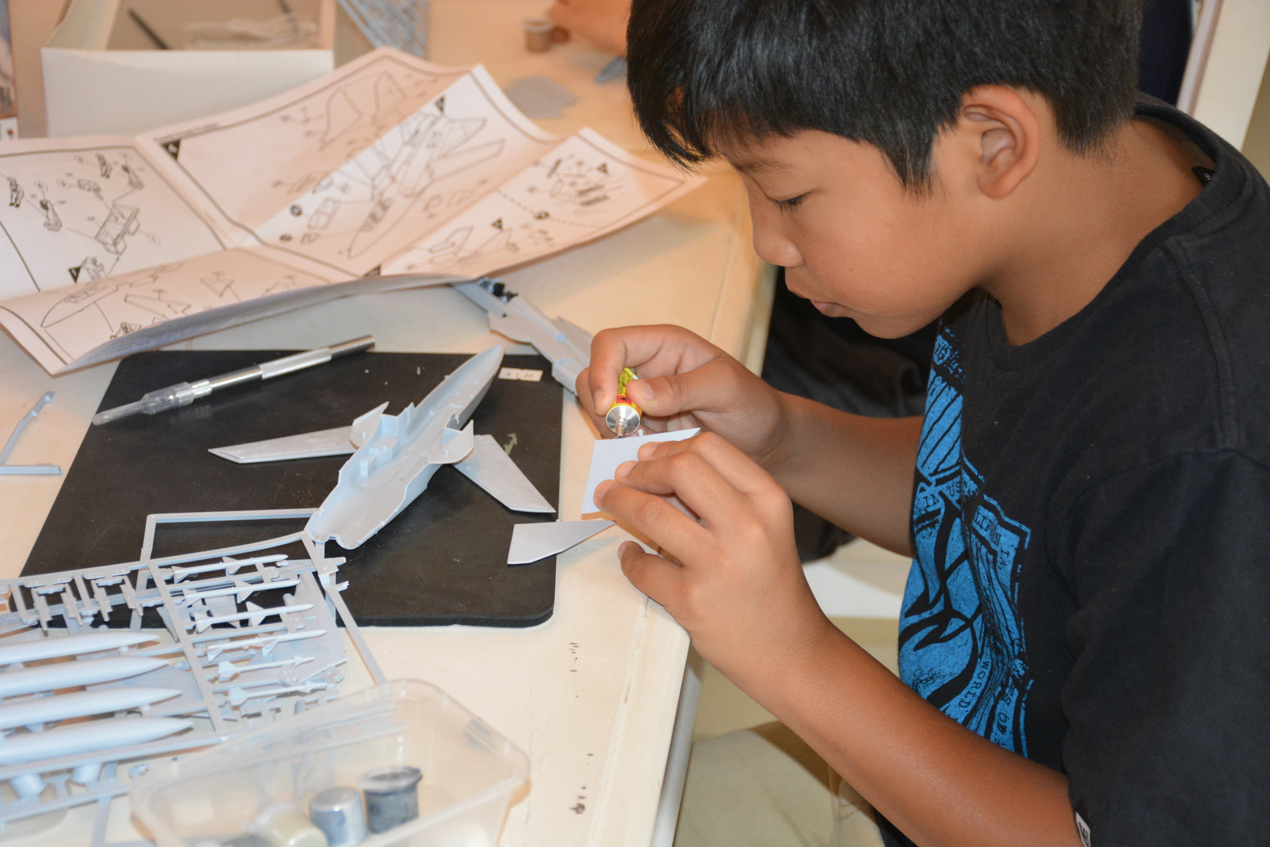 Learning how to put together a plastic model kit. -