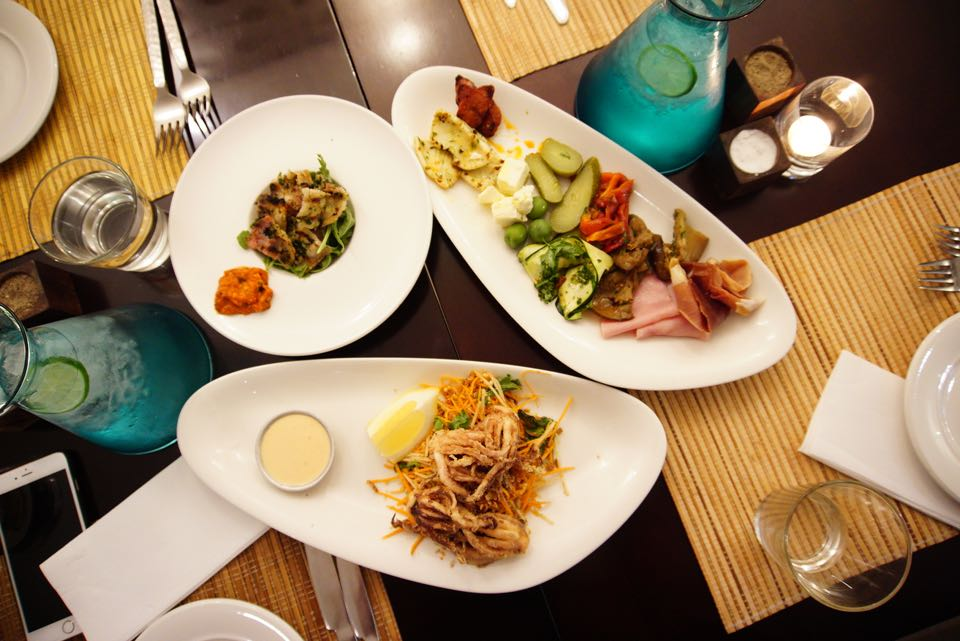 Top left: Grilled strips pork belly, Antipasti platter and the squid tentacles with fresh Vietnamese salad