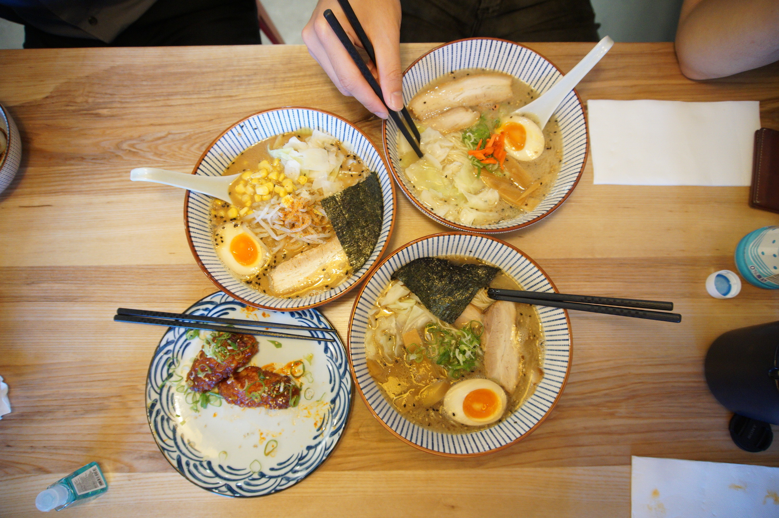 Nomstar Feast - Top L-R: Miso ramen, Shio ramen, Shoyu ramen, two pieces of chicken wings