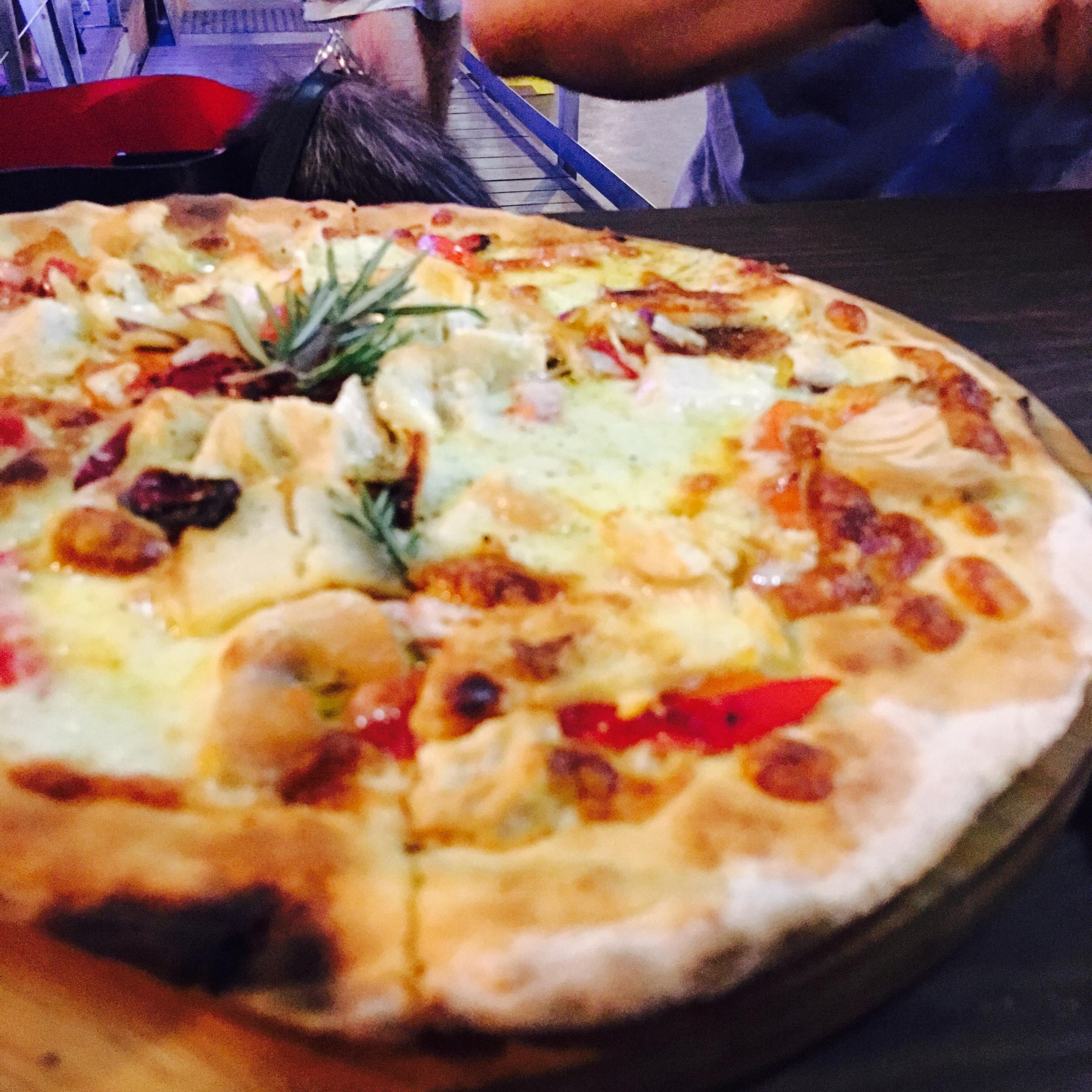 Close of up the Cheesy Tiberio Pizza