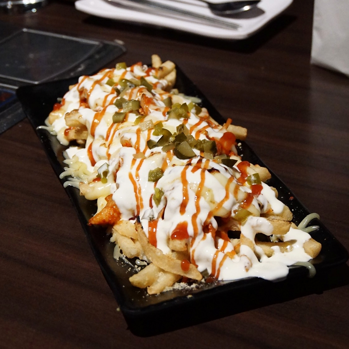 Kimcheese Pork Bulgogi Fries - $20