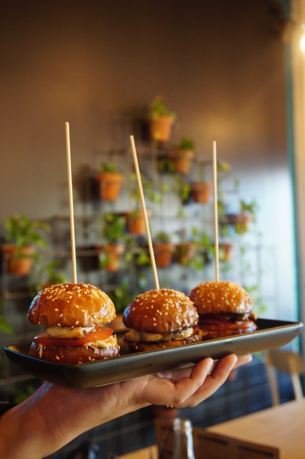 $12 sliders of fish, chicken and lamb (L-R)