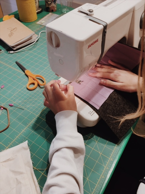 One of our gals was learning how to sew a roll-up case for her pencils and pens.