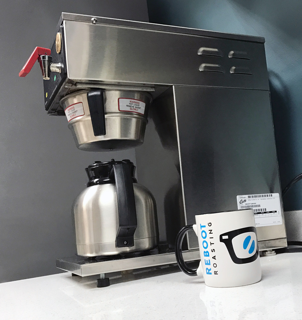 Make sure your coffee maker at work has a thermal carafe and no hot plate like shown here. If you have a glass carafe, you likely have a heat plate. No good!