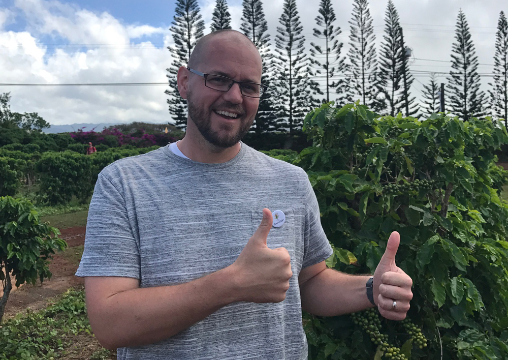 Here we have a big dork just happy to be on a coffee farm.