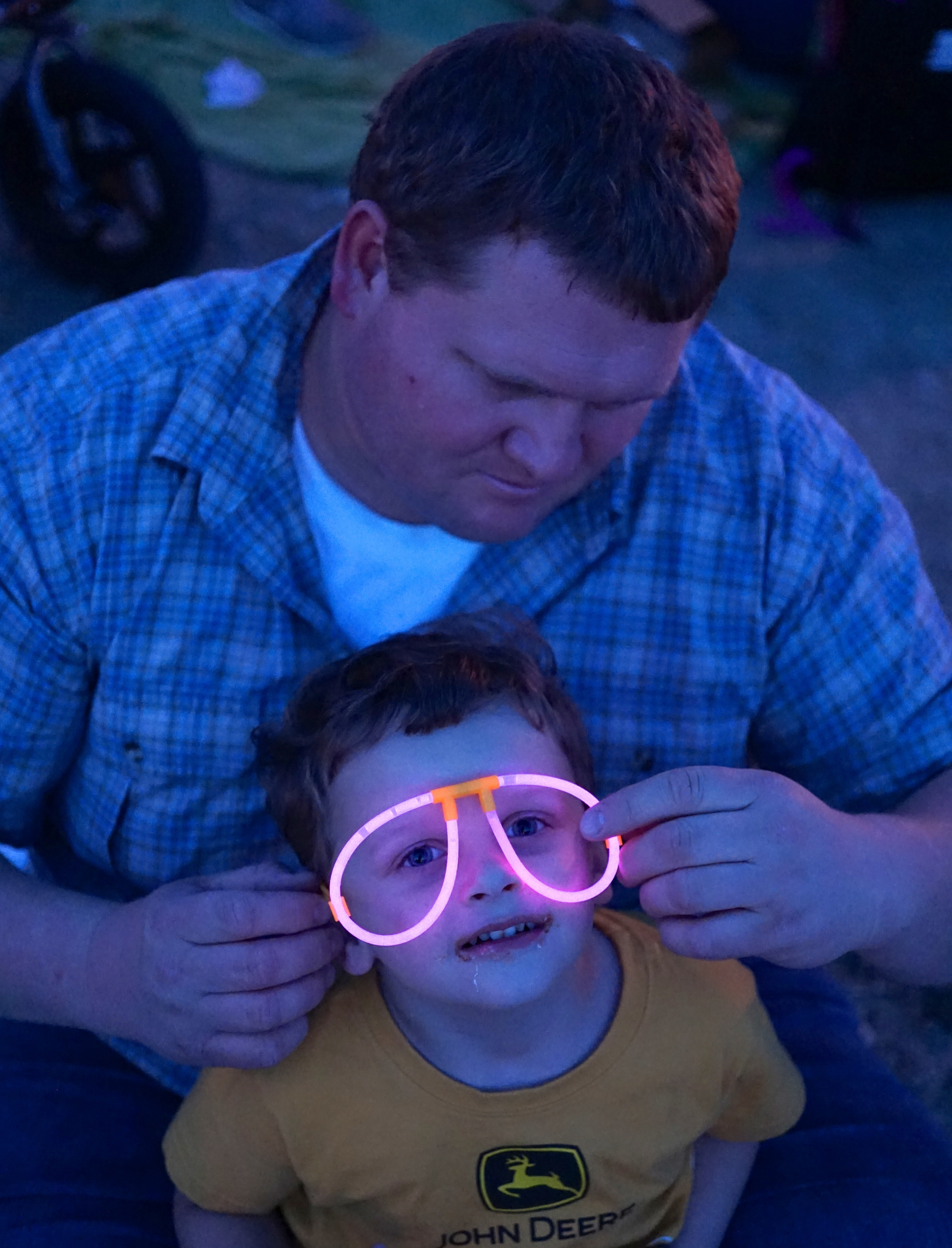 Dave fitting Asher with glow stick glasses