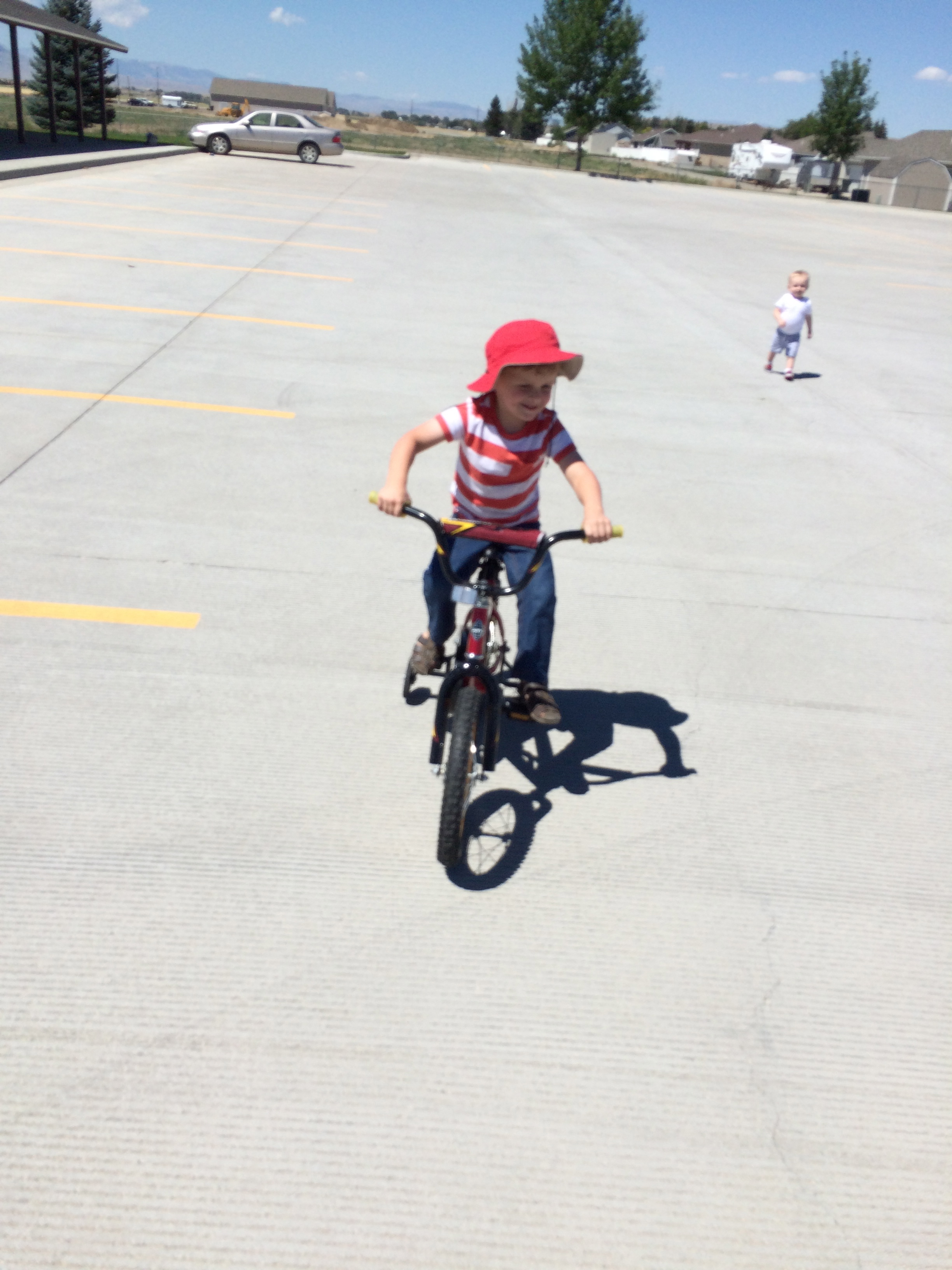 I took Asher to the church parking lot to test him out on the bike that Grandpa bought. He was a natural! (with training wheels) Finn played the jealous little brother role beautifully.