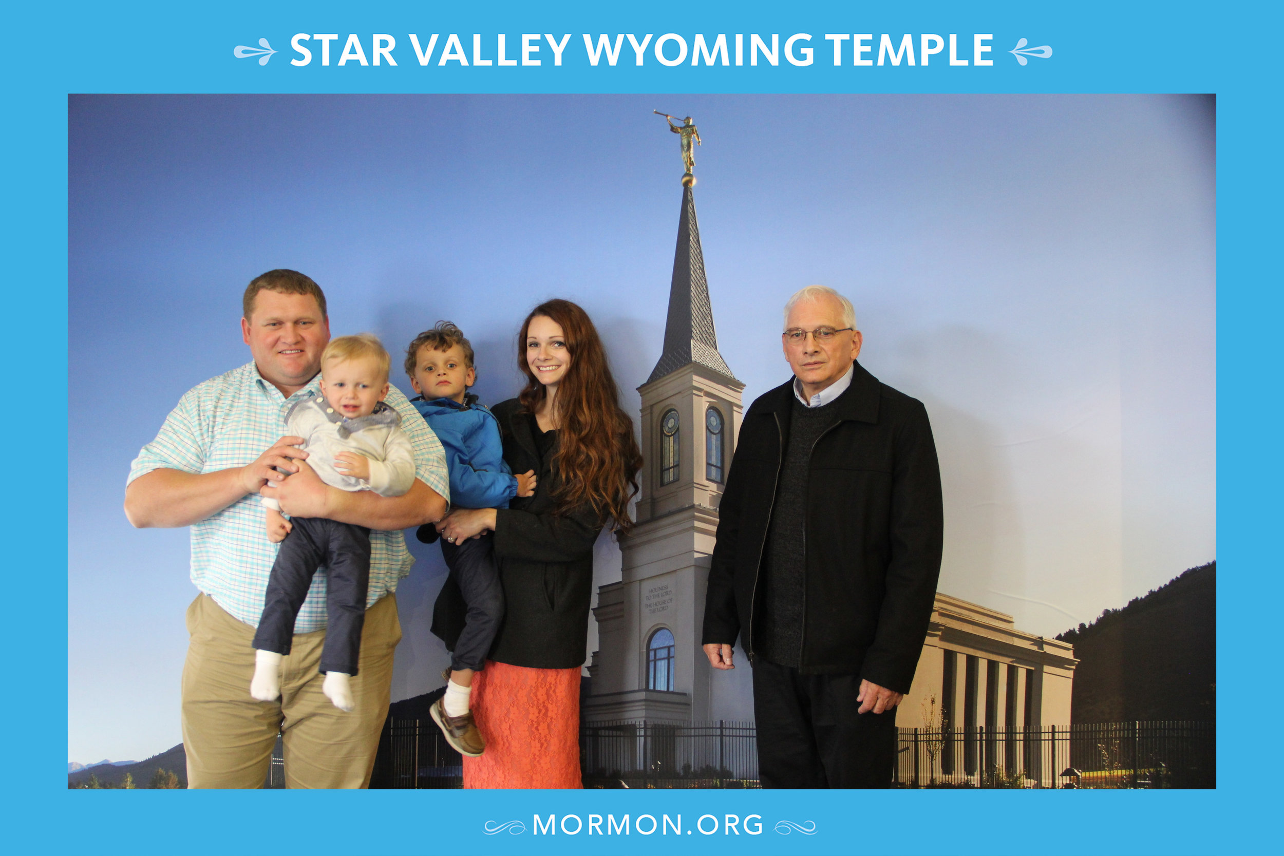 "Our one photo of the open house. It was snowy and freezing outside, so no ""real"" temple pics. Pappy has an anti-smiling-for-photos policy. I don't think he was really so unhappy."