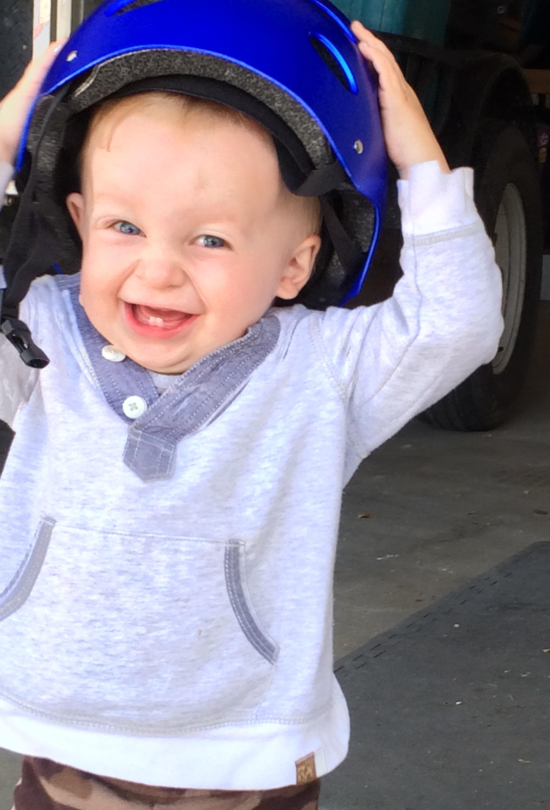Finn LOVES Asher's bike and helmet. (HDR sometimes looks weird on my phone.)