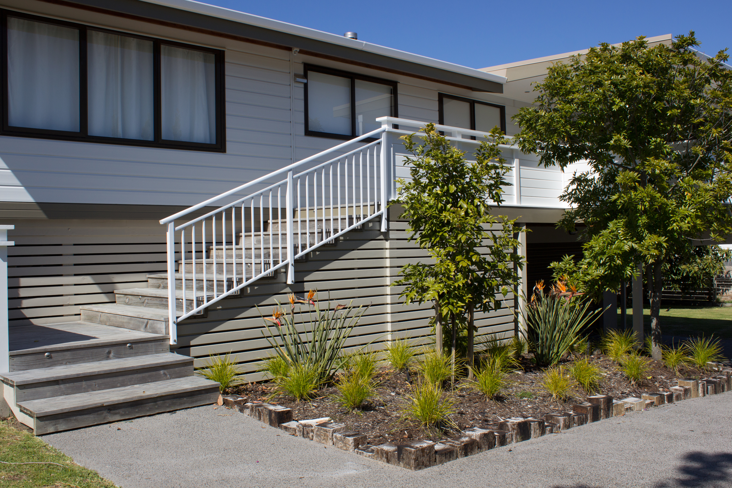 Low maintenance planting, new stairs and deck for all weather entertaining
