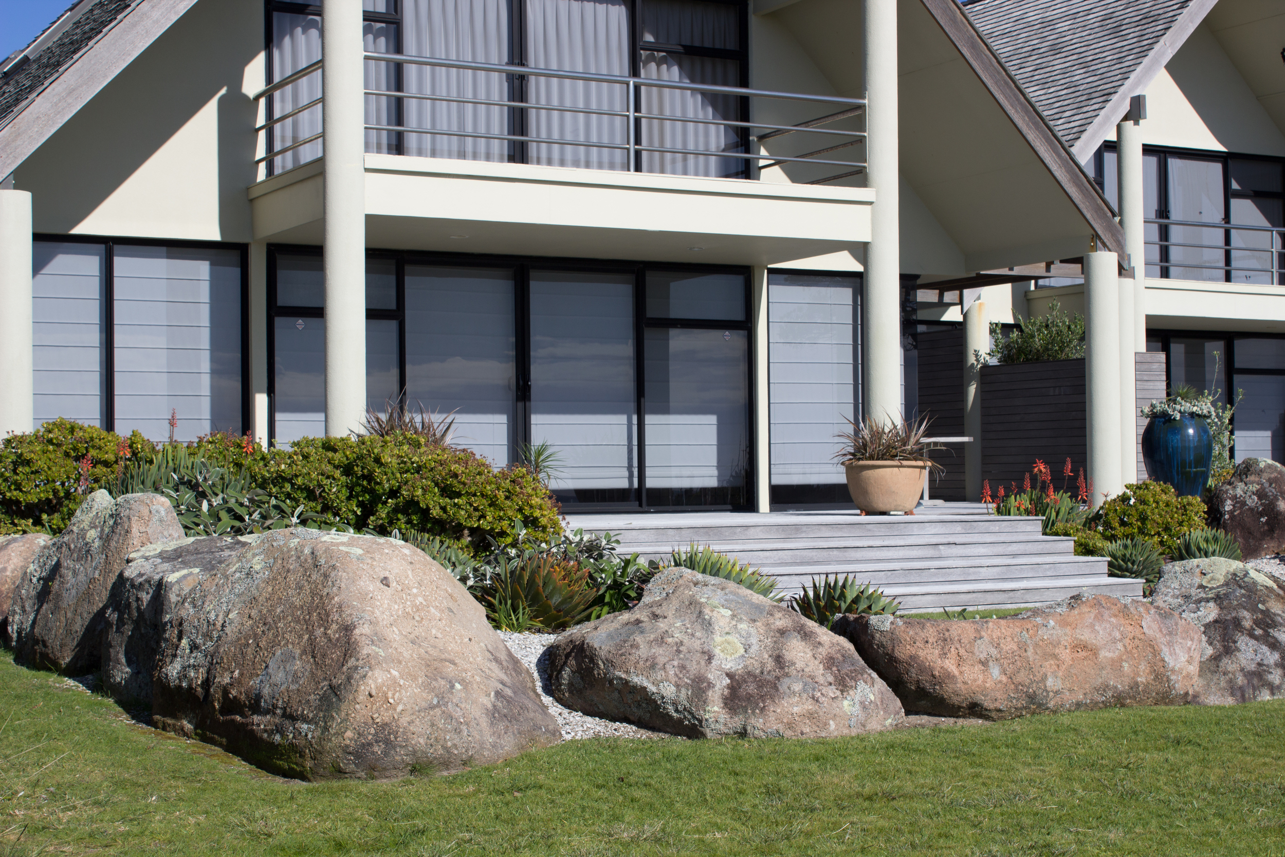 Rocks create a natural border around the front of the property