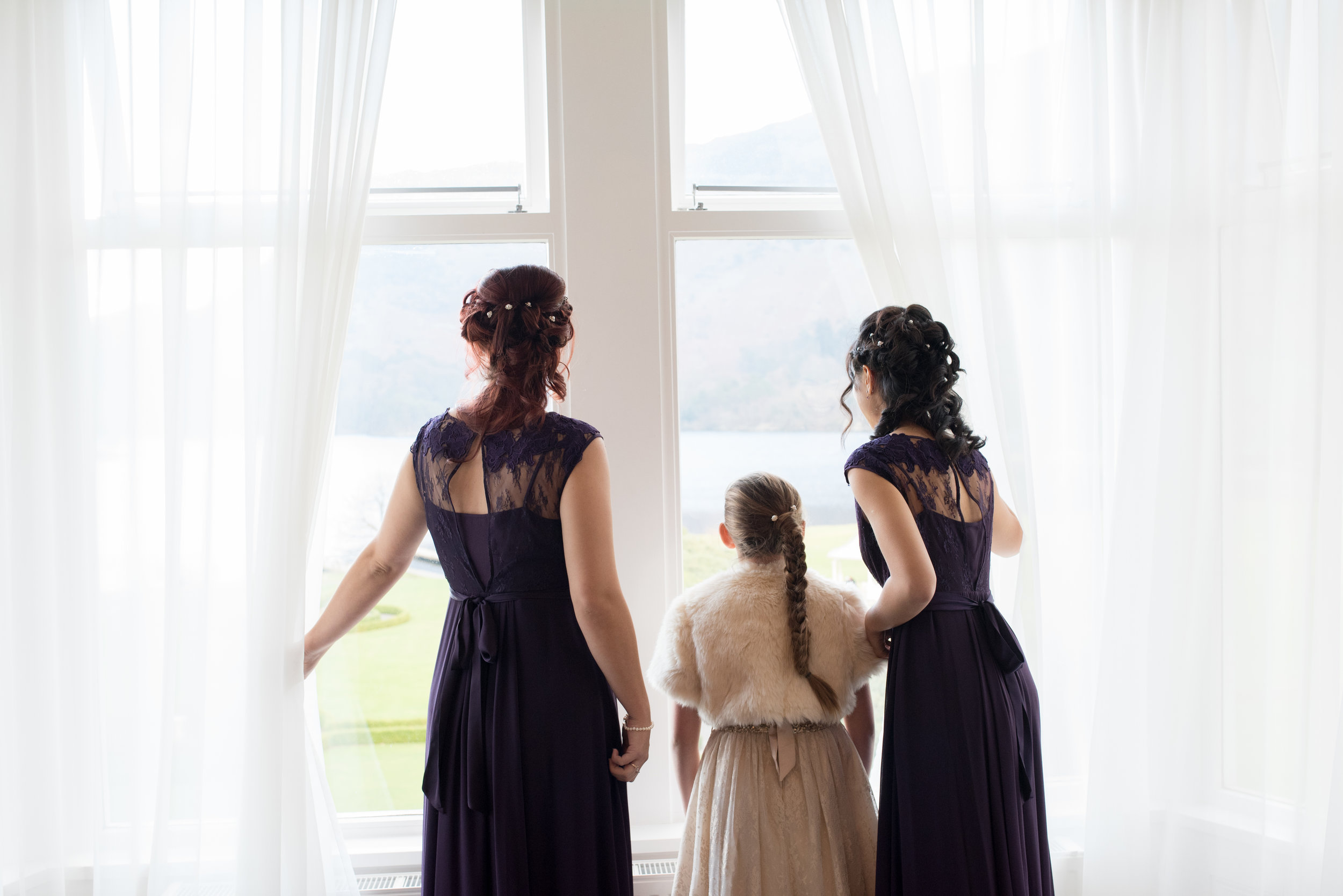 Bridesmaid peeping out of the window