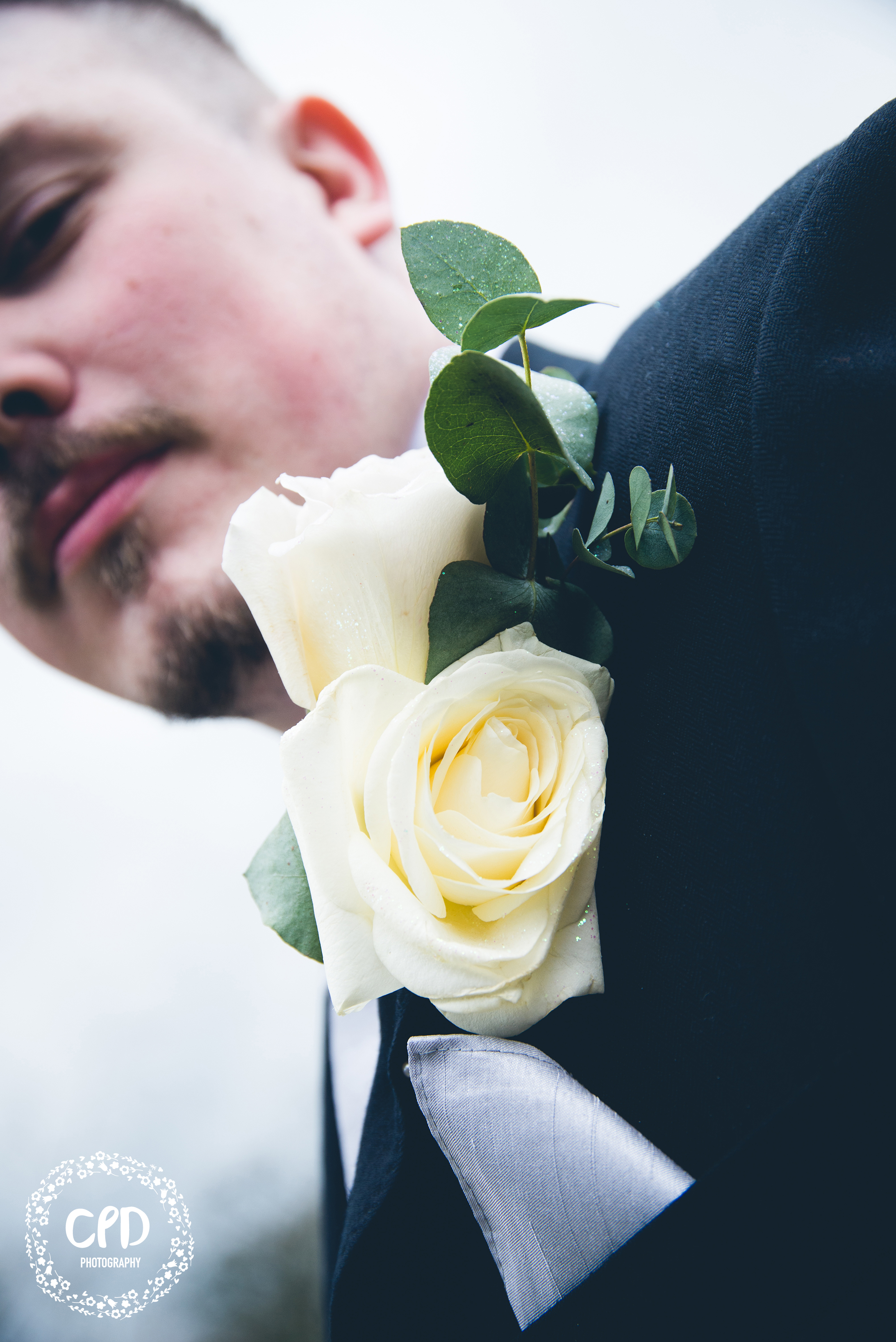 Groom with his buttonhole