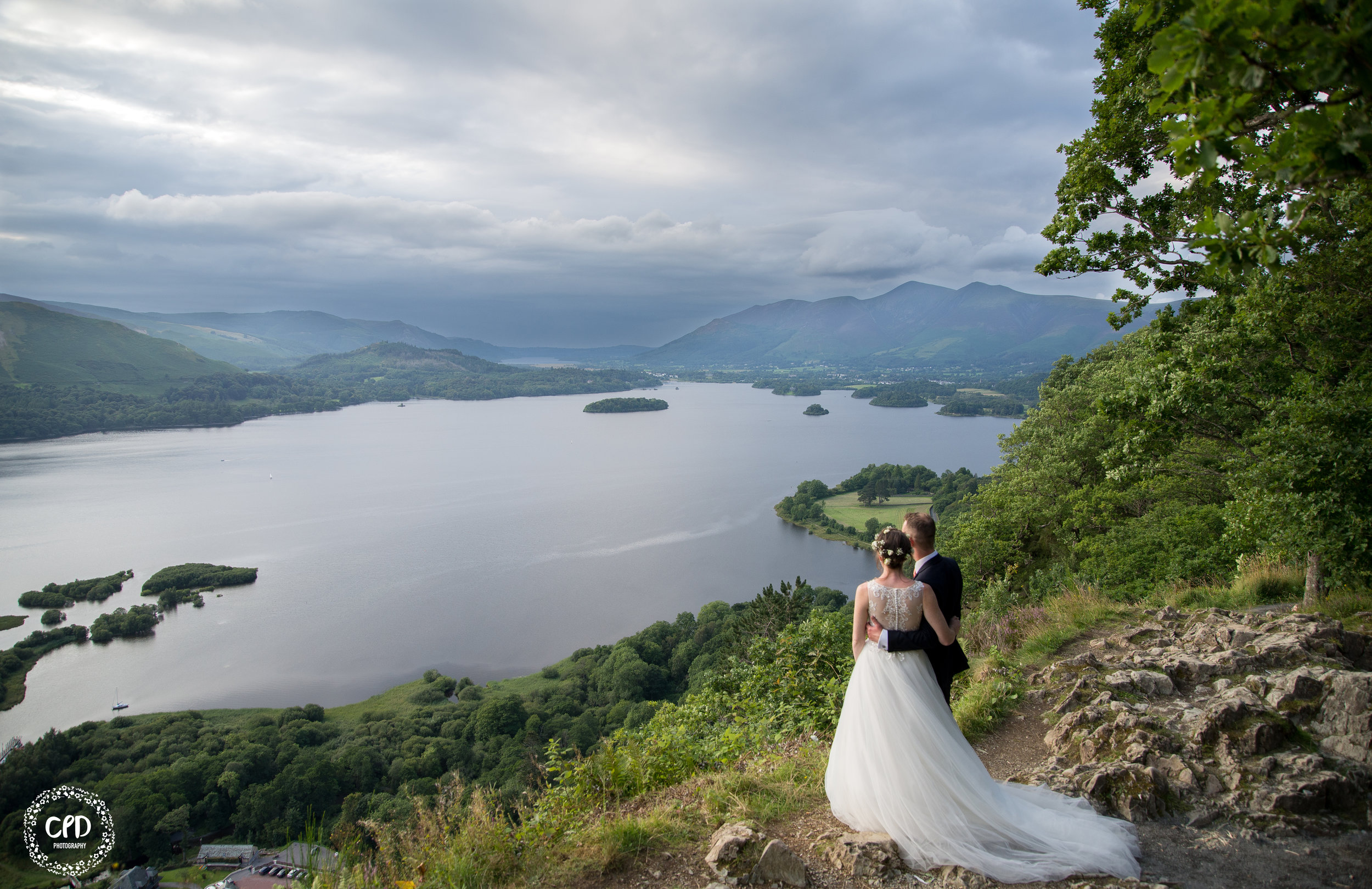 The bride and groom overlooking Derwent Water