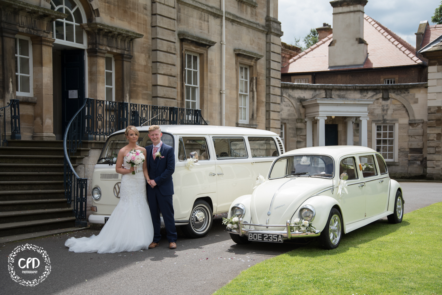 Bride and Groom with the cars