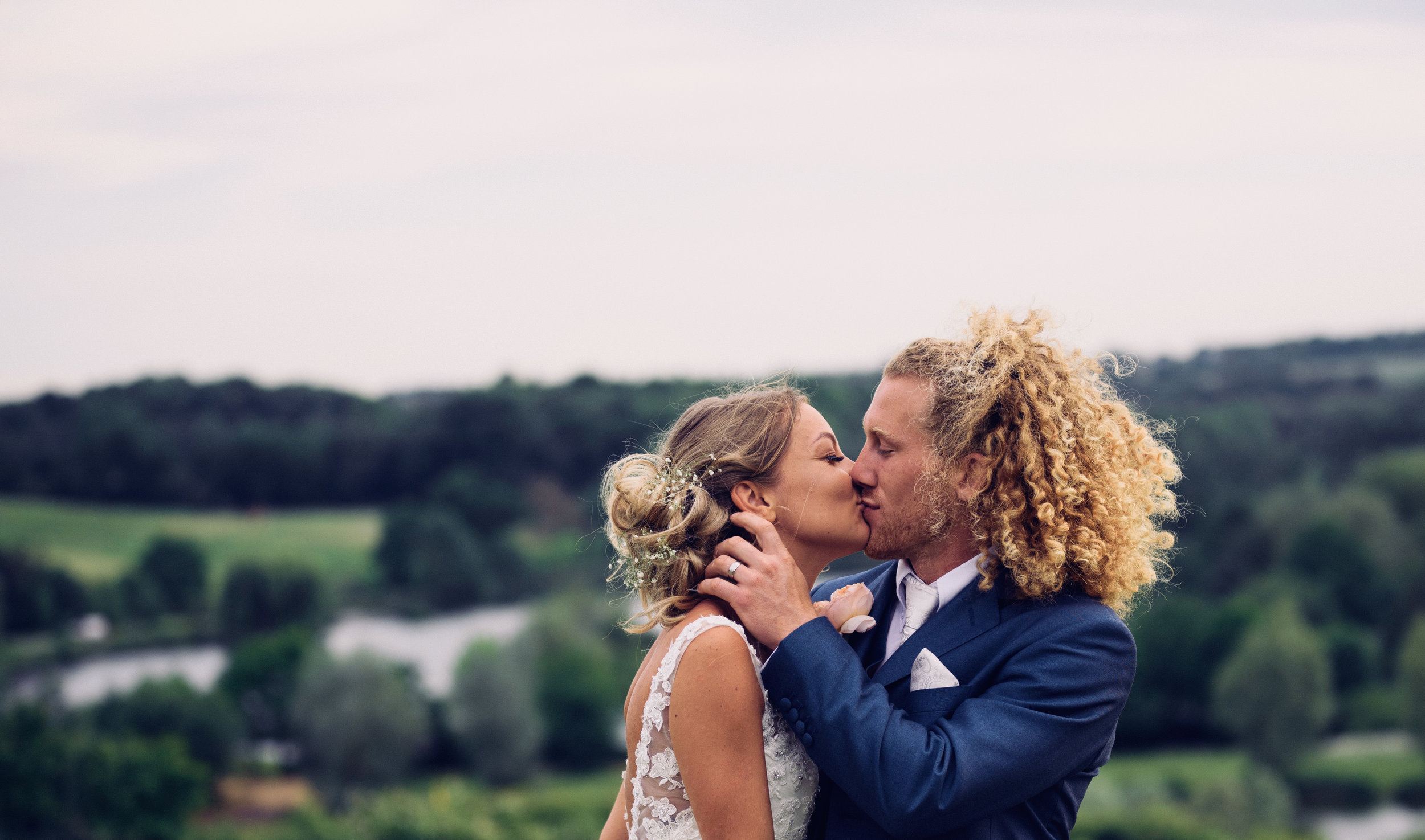 Bride and Groom kissing with a fabulous background